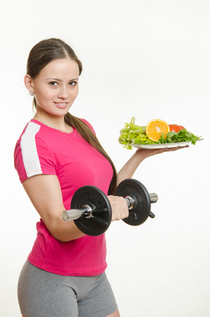 promotes: Young beautiful girl athlete Europeans conducting physical training, and promotes healthy eating Stock Photo