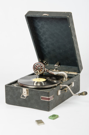 phonograph: Old gramophone, a mechanical device for playing phonograph records, isolated on a white background
