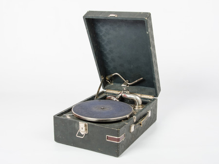 reproducing: Old gramophone, a mechanical device for playing phonograph records, isolated on a white background
