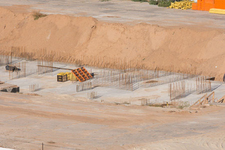 fenced: Volgograd, Russia - October 13, 2015: Aerial view of the fenced area on which the construction of a new multi-storey residential house Editorial