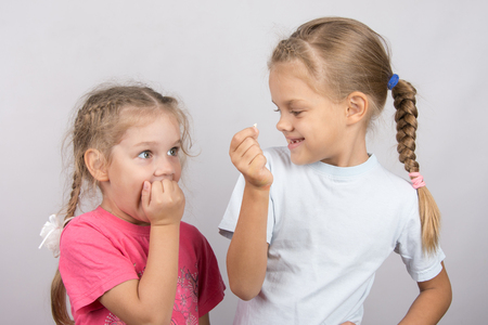 six year old: Six year old girl showing her the other girl had fallen Milk front upper teeth
