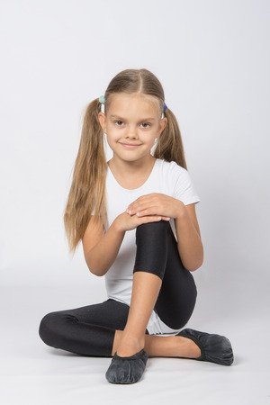 aspiring: six year old girl aspiring gymnast performs a number of training exercises Stock Photo