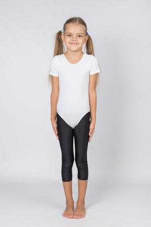 six girl: six year old girl aspiring gymnast performs a number of training exercises Stock Photo