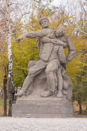 latter: Volgograd, Russia - November 5, 2015: The sculptural group Wounded commander to lead the fight to the last in the square of heroes historical memorial complex To Heroes of the Battle of Stalingrad, Mamayev Kurgan, Volgograd Editorial