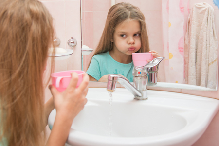rinse: Girl rinse your mouth after brushing