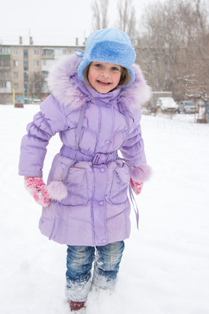 five year old: Happy five year old girl is happy snowy weather Stock Photo