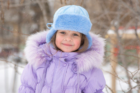 five year old: Portrait of a happy five year old girl in snowy winter weather Stock Photo