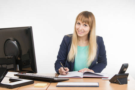 great job: Business woman wrote in a notebook and looked into the frame Stock Photo