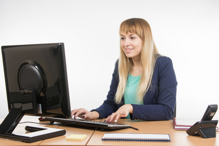 Great: Business woman working at the computer in the office