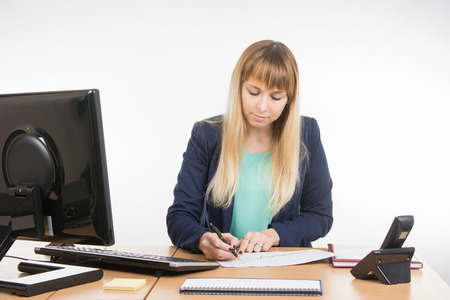 enthusiastically: Office worker enthusiastically studying a paper document