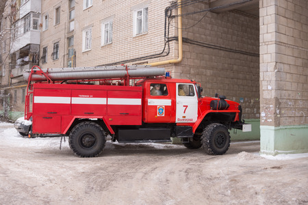 Volgograd, Russia - January 24, 2016: Car Fire Service of EMERCOM of Russia leaves the courtyard of a multistory building after the call Redakční