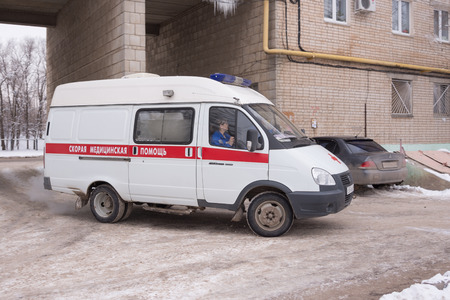 high cost of healthcare: Volgograd, Russia - January 24, 2016: An ambulance calls in the courtyard of a multistory apartment house Editorial