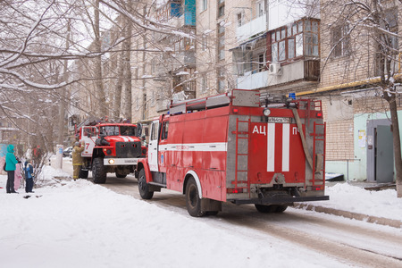 Volgograd, Russia - January 24, 2016: Two cars Fire Service of EMERCOM of Russia arrived to the challenge on suspicion of fire in high-rise apartment building Redakční