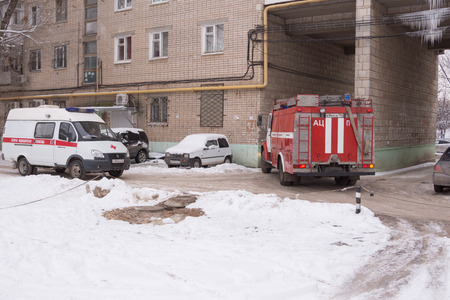 Volgograd, Russia - January 24, 2016: Car Fire Service of EMERCOM of Russia leaves the courtyard of a multistory building after the call, which is also an ambulance Redakční