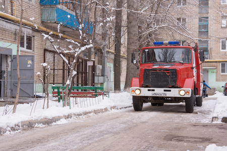 Volgograd, Russia - January 24, 2016: Car fire service Russian Ministry of Emergency Situations arrived on the challenge on suspicion of fire in high-rise apartment building