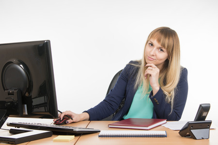 scolded: Upset by a specialist working in the office computer, look into the frame
