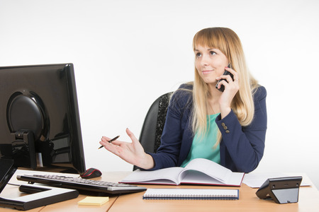 finds: Business woman finds the right information on the phone Stock Photo