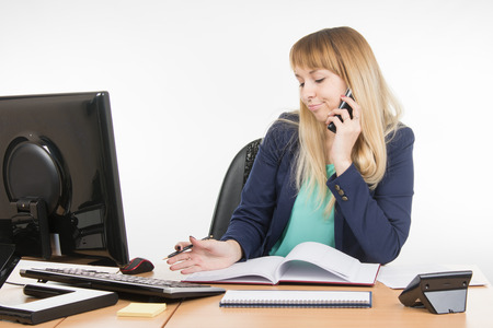 Business woman talking on the phone and understands that a planned meeting did not take place