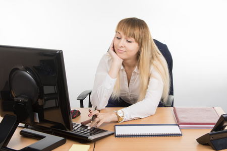 leisurely: Office employee working at a leisurely computer
