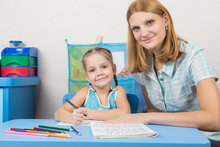 five year old: Tutor and five year old girl engaged in spelling Stock Photo