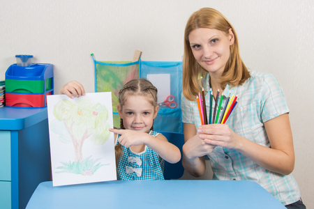 turns of the year: Five-year girl showing on the picture, my mother keeps in the hands of colored pencils