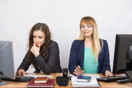 collaborators: The situation in the office - the phone rang, the two collaborators looked at him Stock Photo