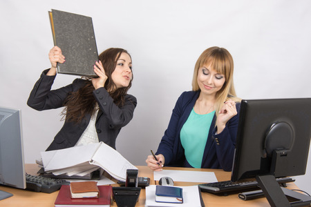 slacker: The girl in the office threatens to hit another folder employee
