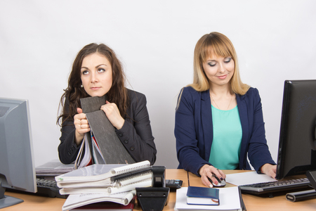 slacker: Female colleagues in the office, one hates to work, like a second job Stock Photo