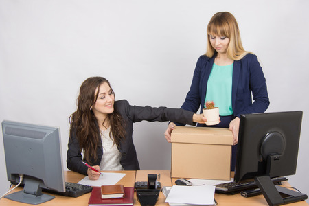 sacked: Office employee happily helps collect things sacked colleague