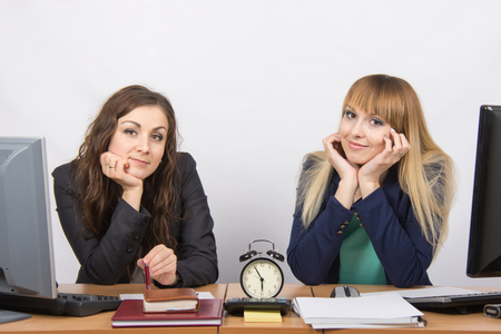 slacker: Two office workers checked against the clock at the end of the working day Stock Photo