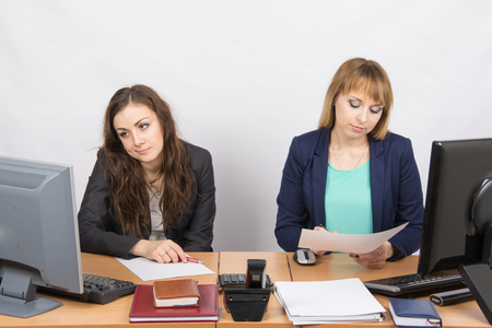 animosity: Office Workers of despondently sitting at a desk