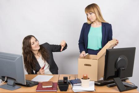 dismissed: Office gesture girl humiliates the dismissed colleague