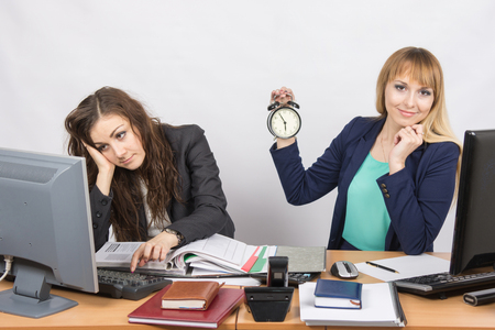 slacker: Two office workers wait for the end of the working day Stock Photo
