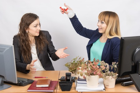 intrusive: Office employee-grower sprinkles water from pulivizatora on irritated colleague