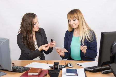 enthusiastically: Office workers enthusiastically share the secrets of make-up with each other