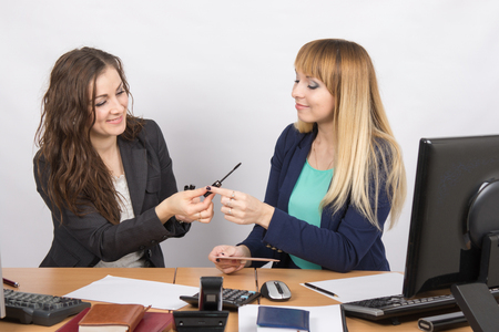 enthusiastically: Office workers talking enthusiastically about cosmetics at your desk