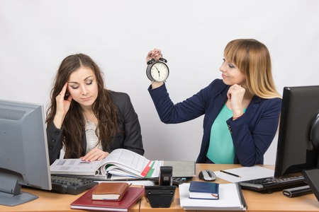 In the office at the end of the working day is one staff member would look at the clock and the other continues to work