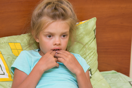 wean: Six-year girl looks thoughtfully at one point and keeps finger in mouth