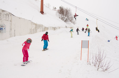 dombai: Dombay, Russia - February 7, 2015: People ride on the snow-covered slopes of the ski resort Dombai