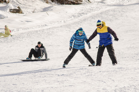 teaches: Dombay, Russia - February 7, 2015: The instructor teaches how to ski on snow downhill ski training on the resort Dombay