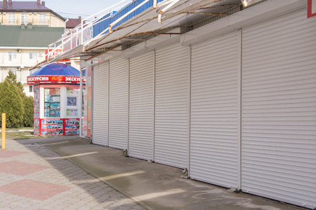 excursions: Vityazevo, Russia - April 2, 2016: closing of the trading pavilions and kiosk excursions on a deserted street in the seaside village of Vityazevo, a suburb of Anapa Editorial