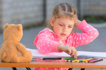 desired: Girl chooses carried away drawing pencil with the desired color
