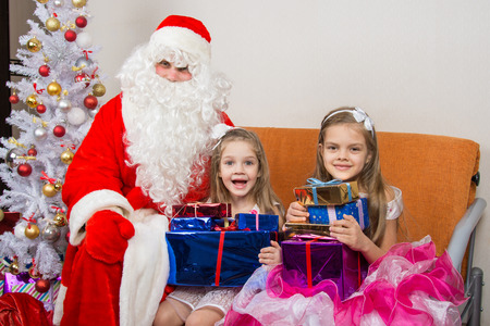 cherished: Santa Claus gave presents to the children, and together looked in the frame