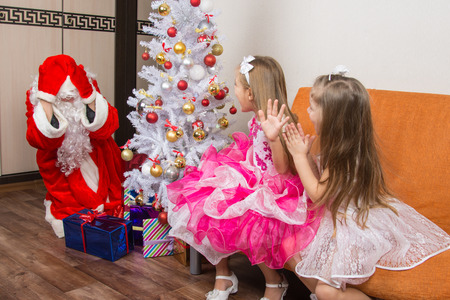 cherished: Two girls saw Santa Claus who brought them gifts