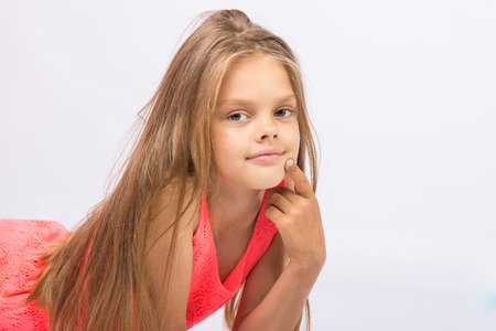conceived: Portrait of a seven-year Conceived girl on a white background