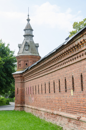 loophole: Sergiev Posad - August 10, 2015: Old wall extending from the retail shops around pafnutevskigo garden at Holy Trinity St. Sergius Lavra in Sergiev Posad Editorial