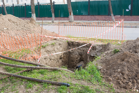 dug: Dug pit fenced for replacing electric cables underground