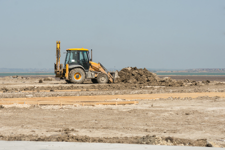 dub: Excavator prepare the site for construction Stock Photo