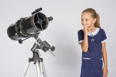 ufology: Seven-year girl with interest looking at a reflector telescope