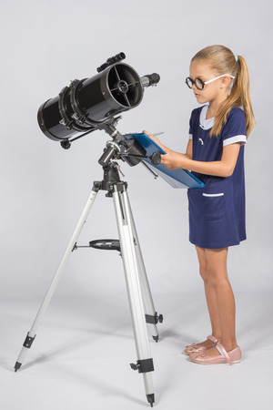 astronomer: The young astronomer with glasses writes observations